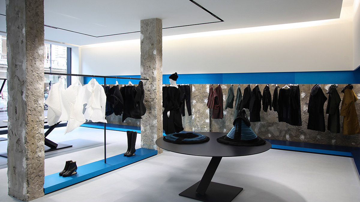 b2a27ec38e Raw concrete pillars and blue panels create a distinctive, stripped back  feel to the new Issey Miyake flagship store in London. Designed by the  Japanese ...